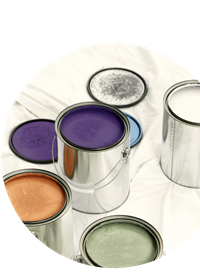 Open tins of coloured paint on a dust sheet