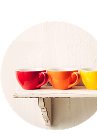 Different coloured cups on shelf